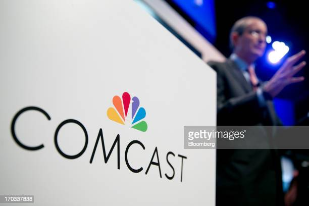 The Comcast Corp logo is seen as Brian Roberts chairman and chief executive officer of Comcast Corp right speaks during a news conference at the...