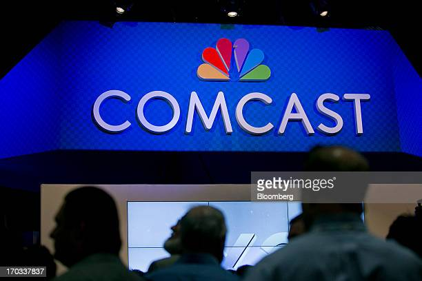 The Comcast Corp logo is seen on the exhibit floor at the National Cable and Telecommunications Association Cable Show in Washington DC US on Tuesday...