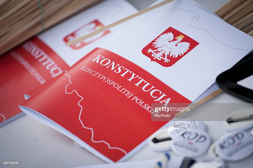 KOD, the comity for the protection of democracy on 3 May 2016 in Bydgoszcz, Poland, handed out copies of the Polish constitution to people willing to sign for receiving. KOD has been a popular, self financed movement since the conservative PiS party has had a majority in government in late 2015. The party, run by the former president Lech Kaczynskis brother Jaroslaw has temped to replace judges on the constitutional panel and change law in its favor leading many to worry about the state of democracy in the country.