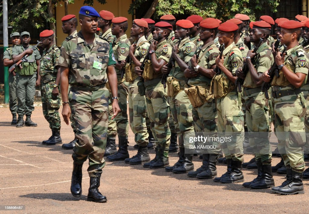 The commander of the regional African force FOMAC Jean-Felix Akaga reviews troops, on January 2, 2013 in Bangui after a press conference during which he warned rebels from the SELEKA coalition in the Central African Republic against any attempt to take Damara, the last strategic town between them and the country's capital Bangui, saying it would 'amount to a declaration of war.' The rebels, who began their campaign a month ago and have taken several key towns and cities, have accused Central African Republic leader Francois Bozize of failing to honor a 2007 peace deal.