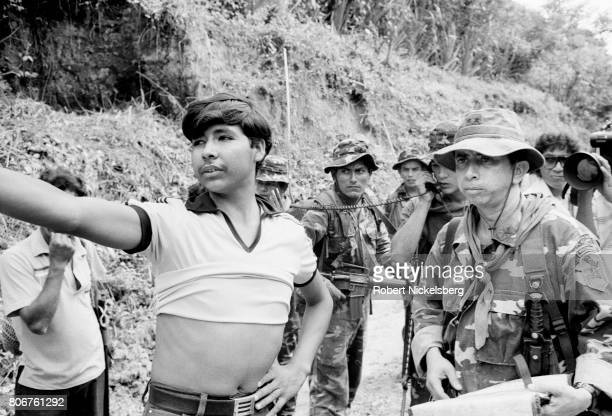 The commanding officer of the Atlacatl Battalion Lt Col Domingo Monterrosa right questions a local resident as his forces advance during a military...