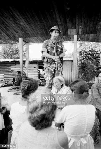 The commanding officer of the Atlacatl Battalion Lt Col Domingo Monterrosa center addresses local residents as his soldiers pursue guerrillas from...