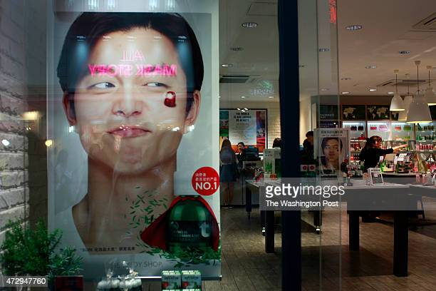 The commercial pictures of a cosmetic brand with South Korean actor Kong Yoo are dispalyed in the shop at Myeongdong shopping street in Seoul South...