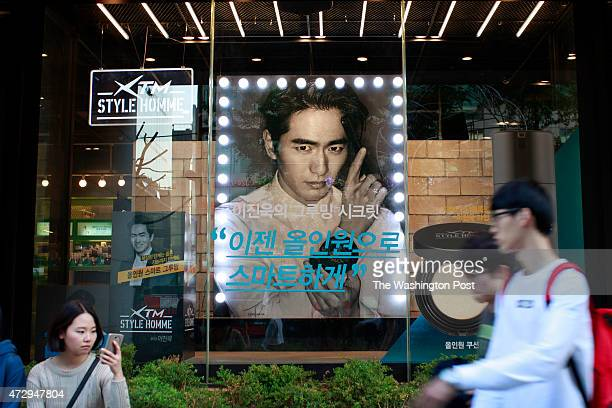 The commercial pictures of a cosmetic brand with South Korean actor Lee Jinwook are dispalyed in the parapharmacy at Hongdae shopping street in Seoul...