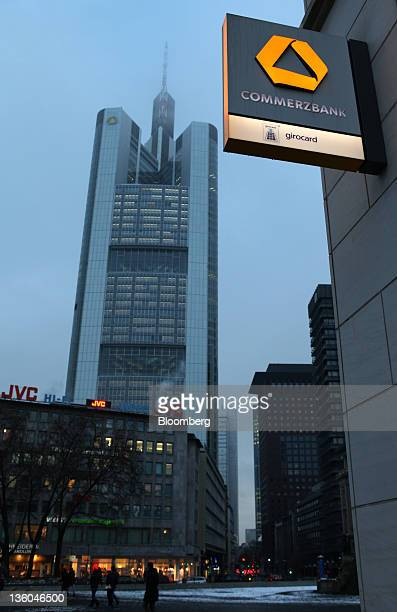 The Commerzbank AG headquarters center are seen next to one of the company's branches in Frankfurt Germany on Tuesday Dec 20 2011 Commerzbank AG...