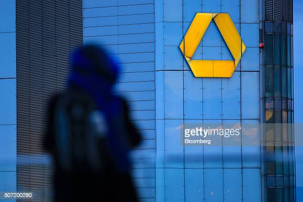 The Commerzbank AG logo sits illuminated on the bank's headquarter offices at dusk in Frankfurt Germany on Wednesday Jan 27 2016 German domestic...