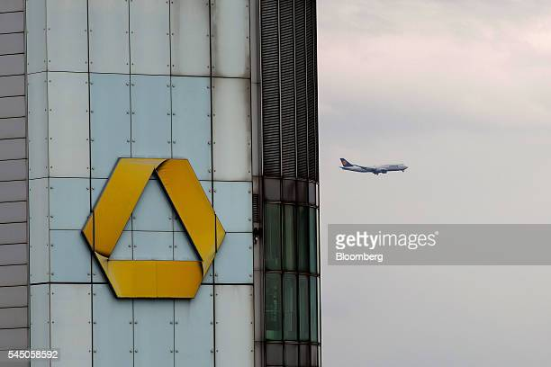 The Commerzbank AG logo sits on the bank's headquarter offices as a passenger aircraft flies beyond in Frankfurt Germany on Monday July 4 2016 The...