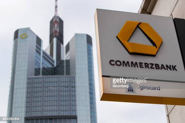 The Commerzbank AG logo sits outside a bank branch as the Commerzbank skyscraper headquarters stands beyond in Frankfurt Germany on Thursday Feb 9...