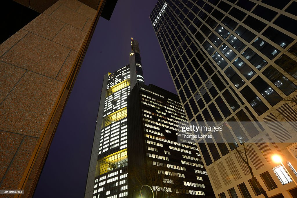The Commerzbank headquarters stand illumenated in the twilight on January 09, 2014 in Frankfurt am Main, Germany. Many of Germany's biggest banks will be announcing their financial results for 2013 in the coming weeks.