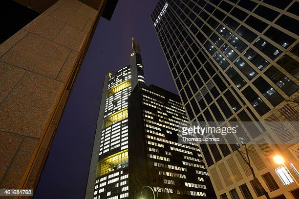 The Commerzbank headquarters stand illumenated in the twilight on January 09 2014 in Frankfurt am Main Germany Many of Germany's biggest banks will...