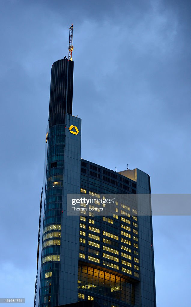 The Commerzbank headquarters stand illuminated in the twilight on January 09, 2014 in Frankfurt am Main, Germany. Many of Germany's biggest banks will be announcing their financial results for 2013 in the coming weeks.