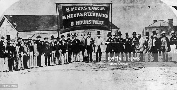 The committee and president of a labour organisation celebrate the 3rd anniversary of the 8hour day in Australia 1858 Their banner reads '8 hours...