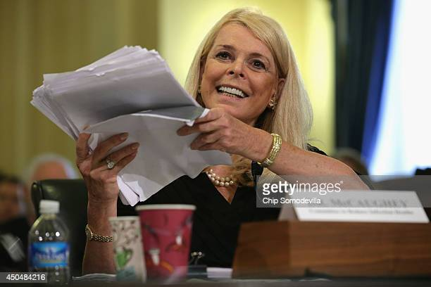 The Committee to Reduce Infection Deaths Chairman Betsy McCaughey holds up a copy of what she said is union contract while testifying before the...