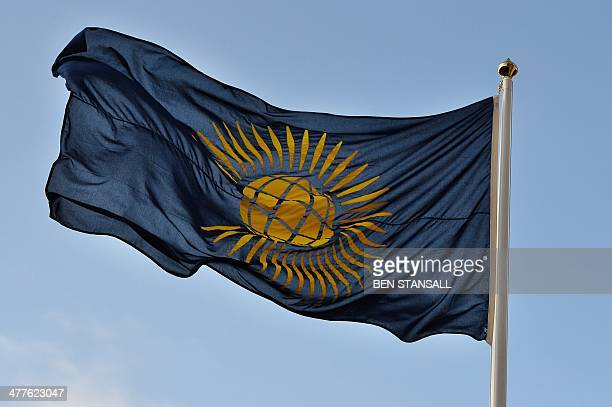 The Commonwealth flag flies outside Westminster Abbey in central London on March 10 2014 as the annual Commonwealth Observance service takes place...
