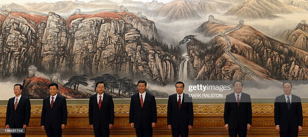 The Communist Party of China's new Politburo Standing Committee, the nation's top decision-making body (L-R): Zhang Gaoli, <a gi-track='captionPersonalityLinkClicked' href=/galleries/search?phrase=Liu+Yunshan&family=editorial&specificpeople=5623429 ng-click='$event.stopPropagation()'>Liu Yunshan</a>, Zhang Dejiang, Xi Jinping, Li Keqiang, Yu Zhengsheng and Wang Qishan meet the press at the Great Hall of the People in Beijing on 15 November 15, 2012. Xi Jinping was appointed China's new leader at the helm of a revamped top power circle that will face the tricky task of setting the planet's second-largest economy on a new course. AFP PHOTO/Mark RALSTON