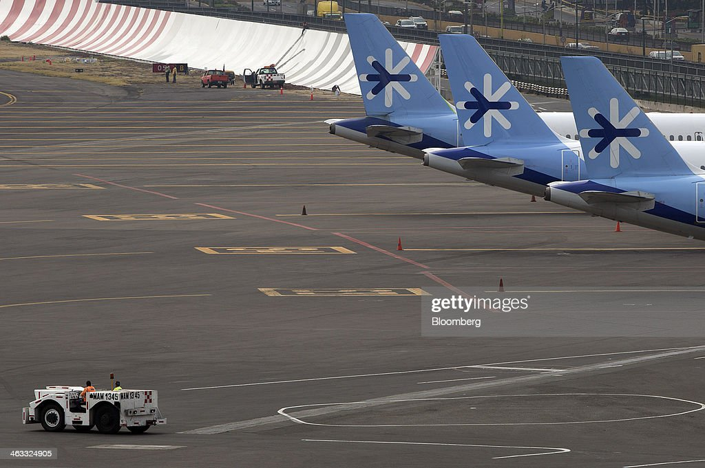The company logo is displayed on the tail fins of Interjet airplanes parked on the tarmac at Benito Juarez International Airport (AICM) in Mexico City, Mexico, on Thursday, Jan. 16, 2014. Interjet, Mexico's second-biggest carrier in 2012, may sell shares this year, Executive President Miguel Aleman Magnani said in November. Photographer: Susana Gonzalez/Bloomberg via Getty Images