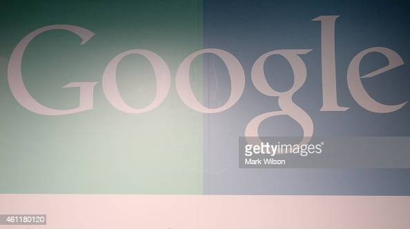 The company logo is painted on the wall in the lobby of Google's Washington headquarters January 8 2015 in Washington DC Google held a news...