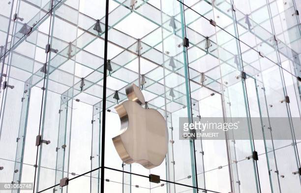 The company logo is seen agains the Apple store structure 26 June 2007 in New York The release of Apple's muchballyhooed iPhone on 29 June is...