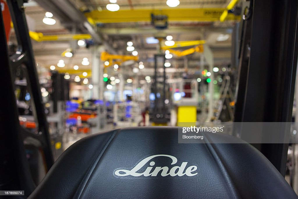 The company logo is seen on the seat of a Linde E25 electric forklift truck as its sits on the production line at the Linde Material Handling GmbH factory, a unit of Kion Group AG, in Aschaffenburg, Germany, on Tuesday, Nov. 12, 2013. Kion Group AG, the German forklift-maker which listed shares in June, is looking to expand its global sales network via acquisitions to catch up with main competitor Toyota Industries Corp. Photographer: Krisztian Bocsi/Bloomberg via Getty Images