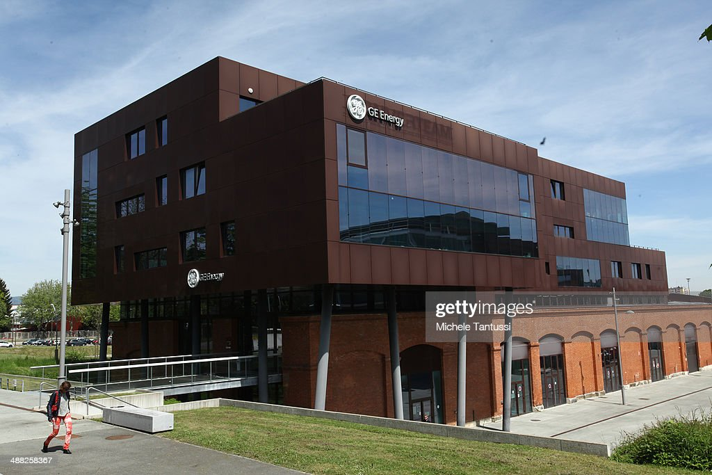 The company logo of engineering company General Electric hangs on the wall of the building on May 5, 2014 in Belfort, France. General Electric is seeking to take over Alstom, one of its main competitors, and so far a counter move by Siemens to buy Alstom instead seems more and more unlikely.