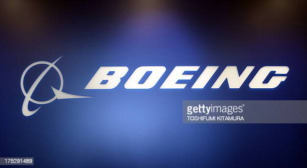 The company logo of the Boeing is displayed at the reception of its Tokyo office on August 2 2013 Boeing's Dreamliner has suffered from a string of...