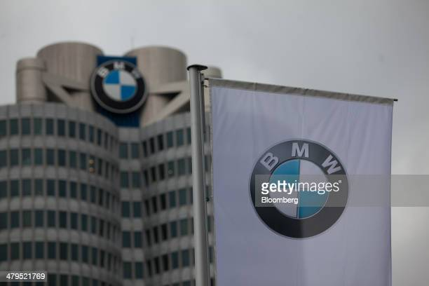 The company logo sits on a banner outside of the Bayerische Motoren Werke AG headquarters ahead of a news conference to announce the company's...