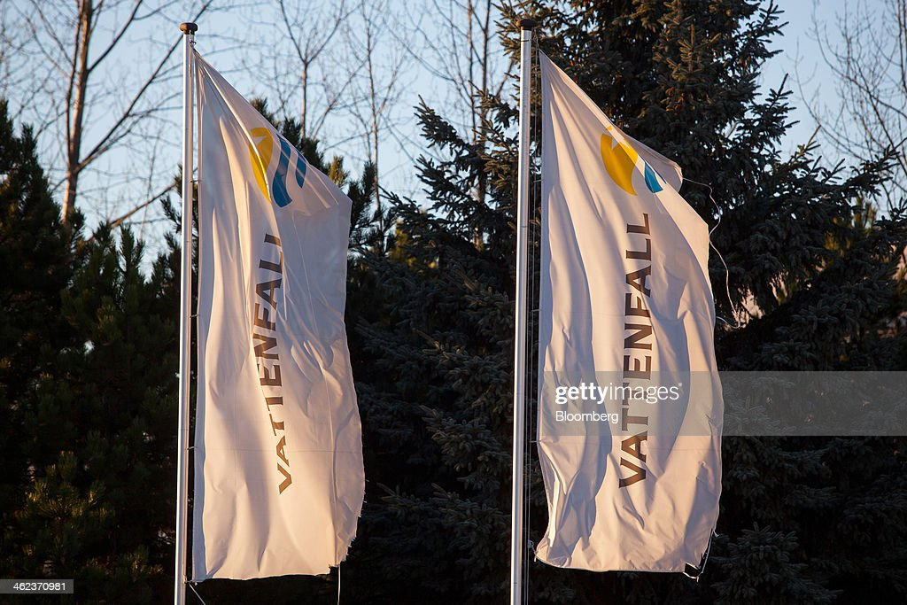 The company logo sits on banners flying at the entrance to Vattenfall AB's open-pit lignite mine in Welzow-Sued, Germany, on Saturday, Jan. 11, 2014. Across the continent's mining belt, from Germany to Poland and the Czech Republic, utilities such as Vattenfall AB, CEZ AS and PGE SA are expanding open-pit mines that produce lignite. Photographer: Krisztian Bocsi/Bloomberg via Getty Images