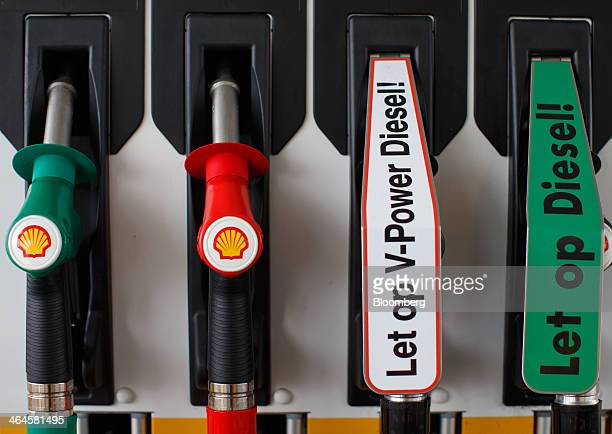 The company logo sits on diesel fuel pumps at a gas station operated by Royal Dutch Shell Plc in Alkmaar Netherlands on Wednesday Jan 22 2014...