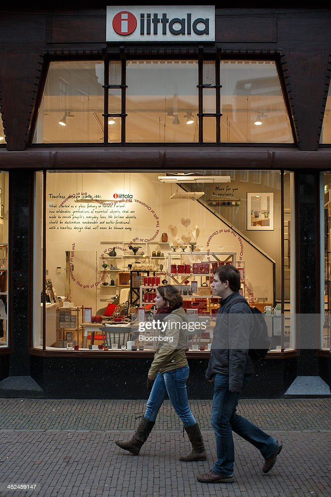 The company logo sits on display above a window display as pedestrians pass an Iittala homeware store, a unit of Fiskars Oyj, in Utrecht, Netherlands, on Friday, Nov. 29, 2013. European government bonds were little changed as investors showed a muted reaction to Standard & Poor's decision to raise its outlook on Spain's debt and strip the Netherlands of its top credit rating. Photographer: Jasper Juinen/Bloomberg via Getty Images