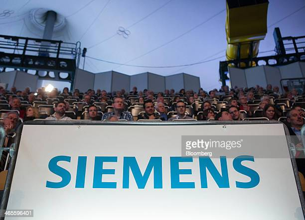 The company logo sits on display as shareholders and employees attend the Siemens AG news conference to announce the company's results at Olympia...