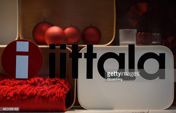 The company logo sits on display on a window of an Iittala homeware store a unit of Fiskars Oyj in Utrecht Netherlands on Friday Nov 29 2013 European...