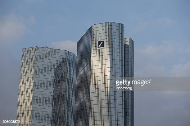 The company logo sits on one of the twin tower skyscrapers of the headquarter offices of Deutsche Bank AG in Frankfurt Germany on Thursday Jan 21...