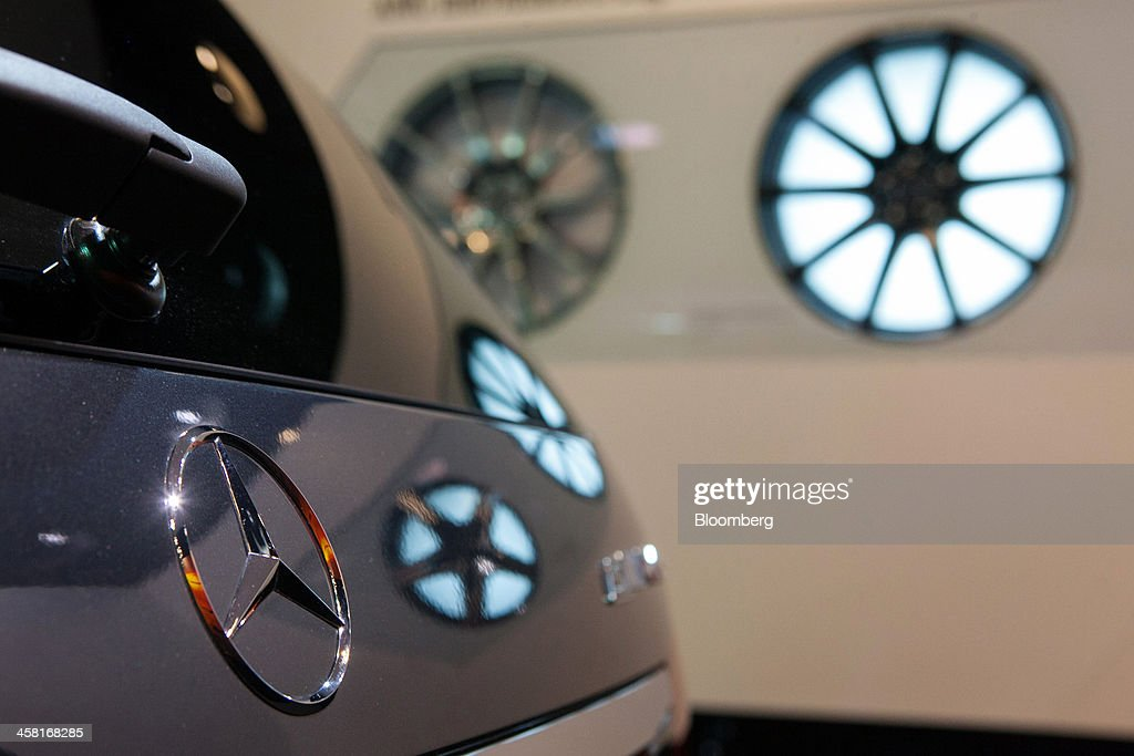 The company logo sits on the boot of a Mercedes-Benz AMG E63 automobile, produced by Daimler AG, inside the company's showroom in Berlin, Germany, on Thursday, Dec. 19, 2013. European new-car sales rose a third consecutive month in November, the longest period of gains in four years. Photographer: Krisztian Bocsi/Bloomberg via Getty Images