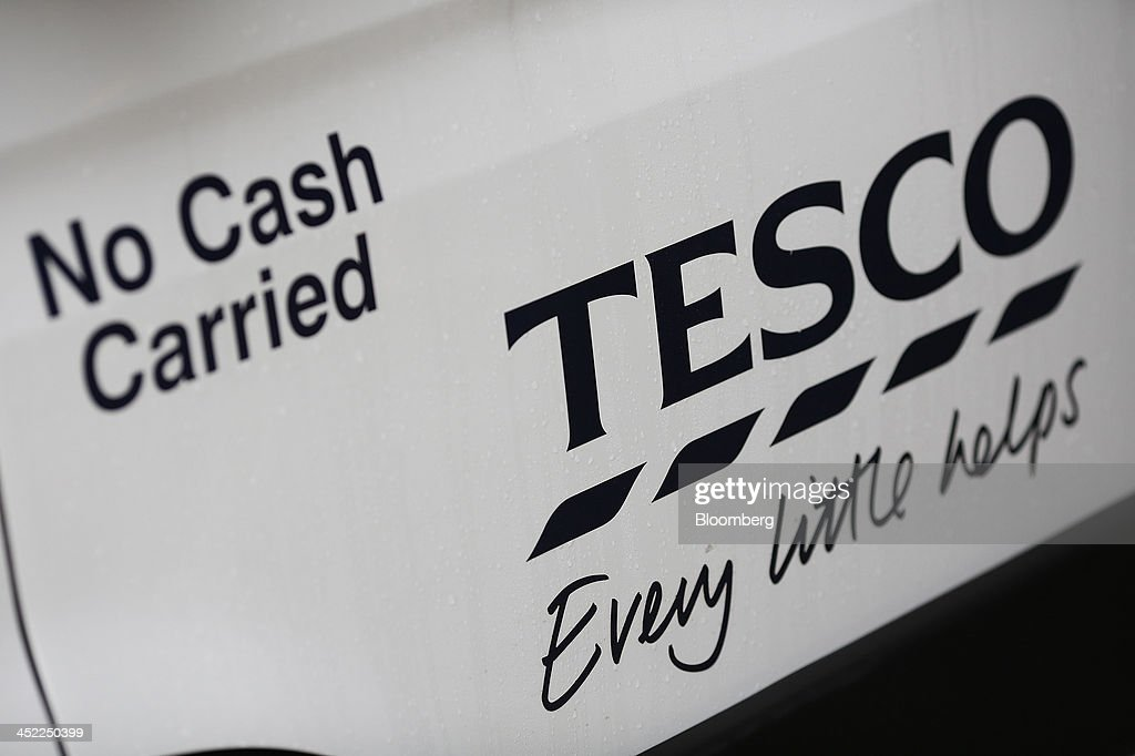 The company logo sits on the side of a delivery truck at a Tesco Plc on-line distribution center, in Erith, U.K., on Wednesday, Nov. 27, 2013. Tesco Plc, the U.K.'s largest retailer, will sell land near some of its Polish hypermarkets to attract additional services around those stores. Photographer: Simon Dawson/Bloomberg via Getty Images