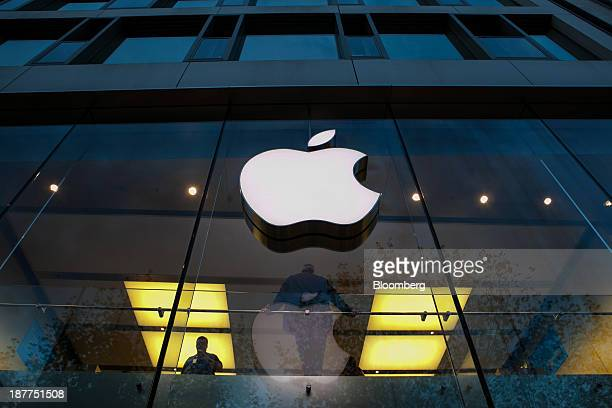 The company logo sits outside an Apple Inc store in Frankfurt Germany on Monday Nov 11 2013 As the euro area struggles out of the worst recession in...