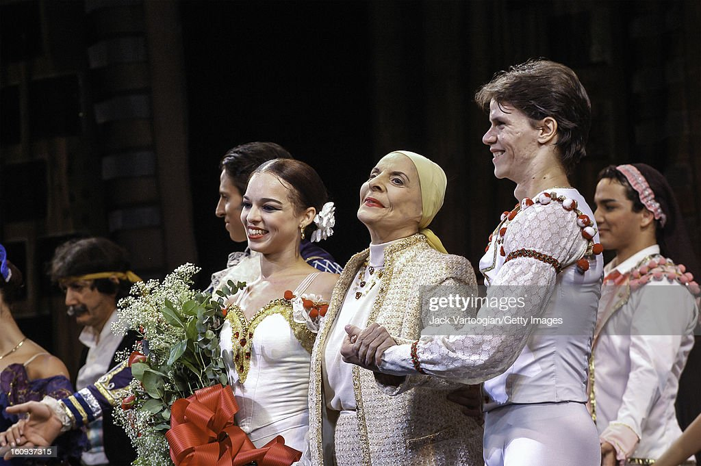 The company of the Ballet Nacional de Cuba takes a curtain call at the conclusion of their production of 'Don Quixote,' City Center, New York, New York, October 15, 2003. Among those pictured are, from left, dancer Viengsay Valdes (with flowers) (as 'Kitri, the beautiful'), ballerina, founder, and director of the company, <a gi-track='captionPersonalityLinkClicked' href=/galleries/search?phrase=Alicia+Alonso&family=editorial&specificpeople=217756 ng-click='$event.stopPropagation()'>Alicia Alonso</a>, and dancer Joel Carreno (as 'Basilio, the town barber').