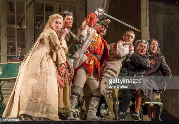 The Company perform on stage during a performance of Jonathan Millers classic production of 'The Barber of Seville' at London Coliseum on October 3...