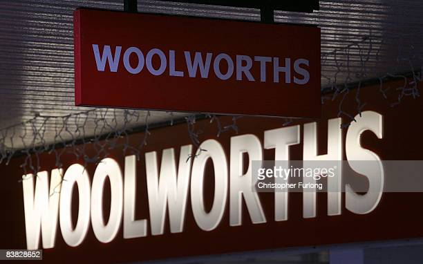 The company sign is illuminated at Northwich branch of Woolworths on November 26 in Northwich EnglandThe troubled retail chain today suspended it's...