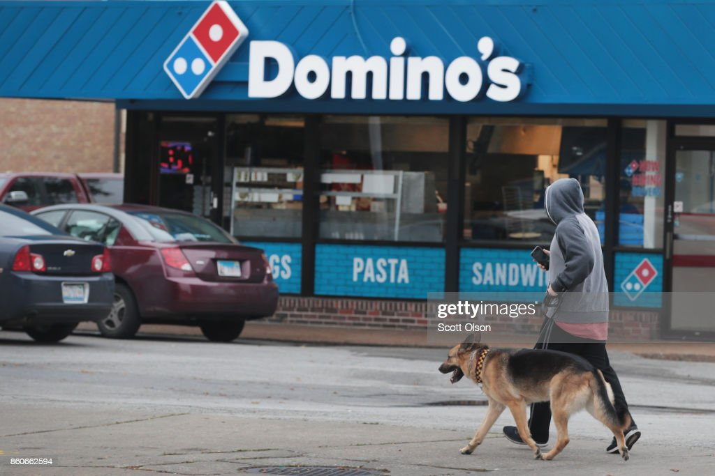 The company's logo across the front of an awning marks the location of a Domino's restaurant on October 12, 2017 in Chicago, Illinois. Shares of the restaurant chain fell 4 percent today despite reporting an increase of more than 8 percent in domestic same-store sales.