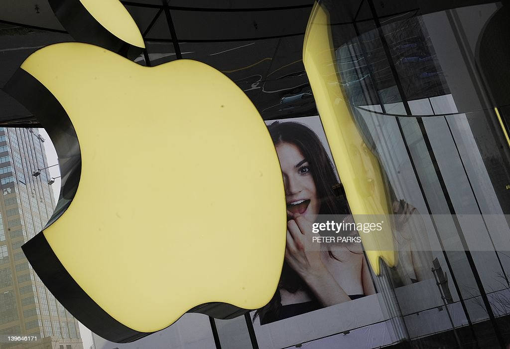 The company's logo sign hangs in an Apple shop in Shanghai on February 24, 2012. Despite suffering a setback in a Shanghai court on February 23, Proview Technology, a financially strapped Chinese company has reportedly opened up a US front in its legal war with Apple over the iPad trademark. AFP PHOTO / Peter PARKS