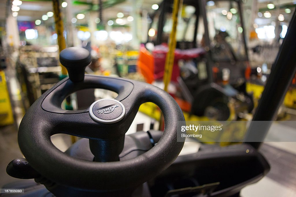 The company's logo sits on the steering wheel of a Linde H35 forklift truck as its sits on the production line at the Linde Material Handling GmbH factory, a unit of Kion Group AG, in Aschaffenburg, Germany, on Tuesday, Nov. 12, 2013. Kion Group AG, the German forklift-maker which listed shares in June, is looking to expand its global sales network via acquisitions to catch up with main competitor Toyota Industries Corp. Photographer: Krisztian Bocsi/Bloomberg via Getty Images
