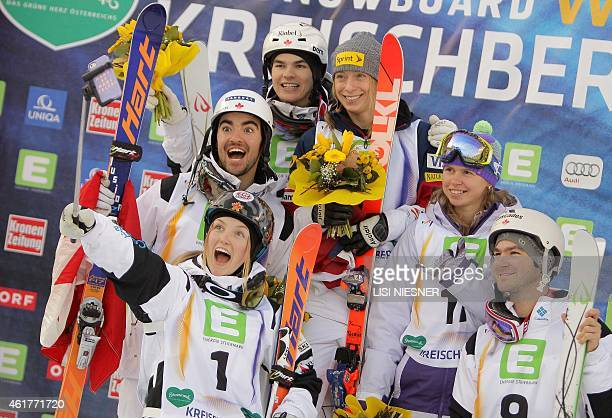 The competitors of the Men's Dual Moguls final winner Mikael Kingsbury of Canada and his compatriots second placed Philippe Marquis and third placed...