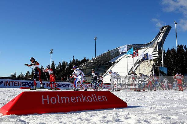 The competitors power away from the start in the Ladies Cross Country 30km Mass Start race during the FIS Nordic World Ski Championships at...
