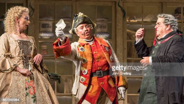 The Compnay perform on stage during a performance of Jonathan Millers classic production of 'The Barber of Seville' at London Coliseum on October 3...