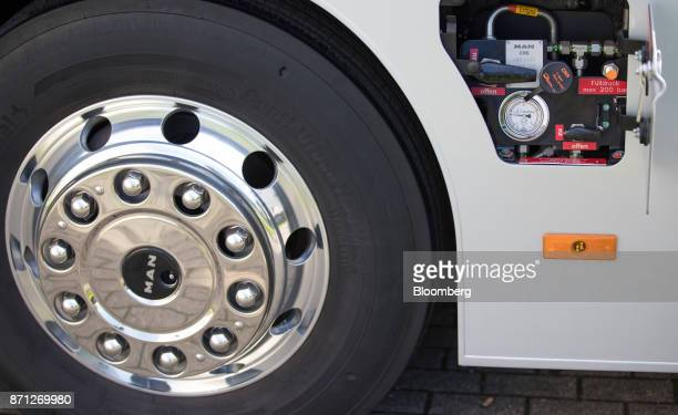 The compressed natural gas fuel tank lid sits exposed beside gauges on a MAN SE bus during the during the Volkswagen AG CNG Mobility Day in Essen...