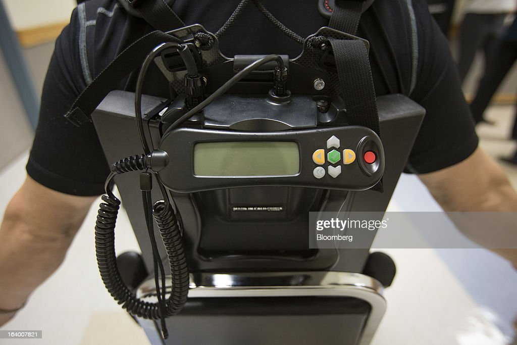 The computer and battery panel of an Ekso Bionics 'exoskeleton,' is worn by Robert Woo at Mount Sinai Medical Center in New York, U.S., on Thursday, March 14, 2013. Wearable machines that enhance human muscle power are poised to leave the realm of science fiction and help factory workers hoist heavier tools, lighten soldiers' loads and enable spinal patients to walk. Photographer: Scott Eells/Bloomberg via Getty Images