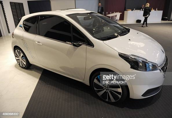 the concept car peugeot 208 hybrid air 2l is unveiled at the psa