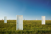 The concept of choice: many doors in a green field
