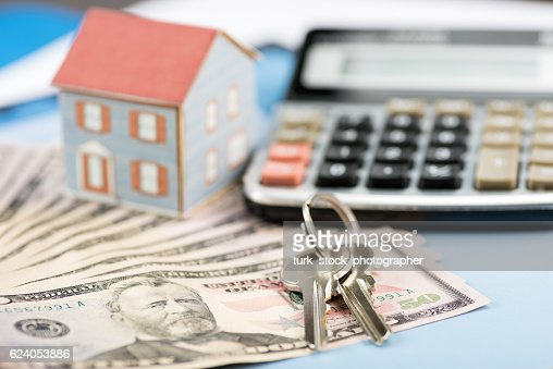 The concept of home ownership and 50 dollars : Stock Photo