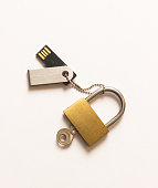 The concept of information storage. Padlock and usb flash drive. locked closed padlock with usb memory stick through it isolated on white background.